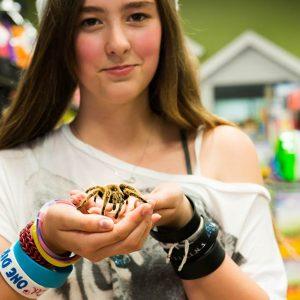 Girl with Tarantula at Friendly Pets